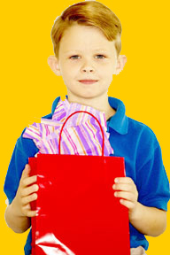 This is a photo of a boy holding bags.