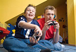 This is a picture of two kids playing a video game.